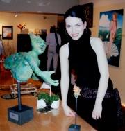 Me standing next to my paper mache mermaid sculpture.
