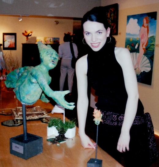 Me standing next to my paper mache mermaid sculpture.